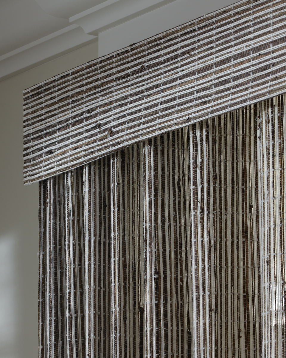 Close Up View Of The Provenance Woven Wood Shades Closed With Continuous Cord Loop Operating System In Den Room Style Transitional Casual